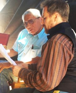 Actor Sam Rockwell, (right), works with LLC board member and Lakota language instructor Ben Black Bear on the set of the new film Woman Walks Ahead.